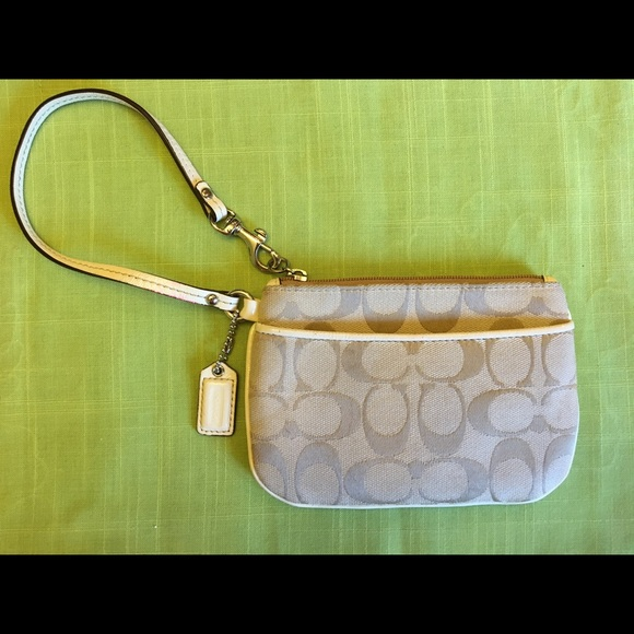 COACH Handbags - COACH wristlet cream colored w/ an outside pocket